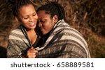 mixed race woman being embraced ... | Shutterstock . vector #658889581