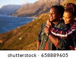 happy mixed race couple smiling ... | Shutterstock . vector #658889605
