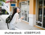 asia woman walking and using a... | Shutterstock . vector #658899145