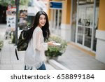 asia woman walking and using a... | Shutterstock . vector #658899184