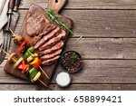 beef steak and grilled... | Shutterstock . vector #658899421