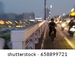 a boy riding a bike  next to... | Shutterstock . vector #658899721