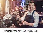 cheerful bartender on a bar... | Shutterstock . vector #658902031