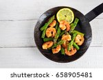 fried prawns or shrimps with ... | Shutterstock . vector #658905481