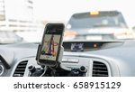 drivign with gps in smartphone  ... | Shutterstock . vector #658915129
