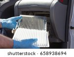 replacing the cabin air filter | Shutterstock . vector #658938694