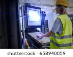 side view of female worker... | Shutterstock . vector #658940059