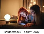 two young girls using tablet... | Shutterstock . vector #658942039