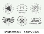 set of vintage surfing logos ... | Shutterstock .eps vector #658979521