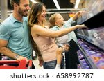 family shopping in their local... | Shutterstock . vector #658992787