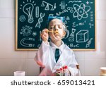 kid doing soap bubbles against... | Shutterstock . vector #659013421