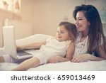 happy young mother with... | Shutterstock . vector #659013469