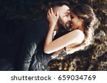 happy couple in black clothes... | Shutterstock . vector #659034769