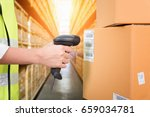 woman scanning barcode from a...