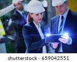 businessman and businesswoman... | Shutterstock . vector #659042551