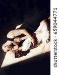 man and woman lie between the... | Shutterstock . vector #659044771