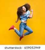 young curly woman looking at... | Shutterstock . vector #659052949