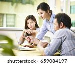 a team of young asian corporate ... | Shutterstock . vector #659084197