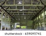 Small photo of Abandoned unworthy hangar inside, among the day