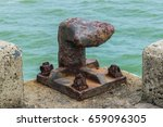 Old Rusted Bollard At A Pier.