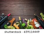 wine bottles with grapes ... | Shutterstock . vector #659114449