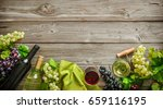 wine bottles with grapes and... | Shutterstock . vector #659116195