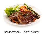grilled beef steaks with...   Shutterstock . vector #659169091