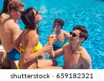 Party At Smimming Pool. Group...