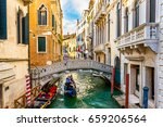 canal with gondola in venice ... | Shutterstock . vector #659206564