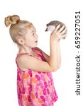 a young girl holding a hedgehog ... | Shutterstock . vector #659227051