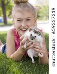 a young girl holding a hedgehog ... | Shutterstock . vector #659227219