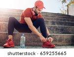man tying jogging shoes.a... | Shutterstock . vector #659255665