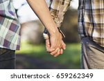 close up of couple holding hands | Shutterstock . vector #659262349
