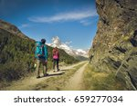 hiking in the beautiful alps ... | Shutterstock . vector #659277034