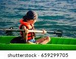 a teenage boy paddling a kayak... | Shutterstock . vector #659299705