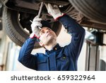 portrait of a mechanic... | Shutterstock . vector #659322964