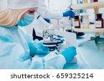 science technician at work in... | Shutterstock . vector #659325214