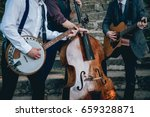 trio of musicians with a guitar ... | Shutterstock . vector #659328871