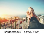 female feet with glossy pale... | Shutterstock . vector #659334424