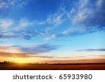 sunset sky over field. | Shutterstock . vector #65933980