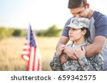 Husband Hugs Wife In The Army