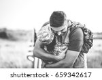 Husband Hugs Wife In The Army...