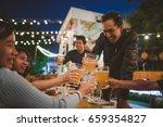 group of friends celebrating... | Shutterstock . vector #659354827