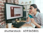 Small photo of elegant beauty agent woman holding personal credit card thinking about whether using e-commerce system paying solving extort virus problem.