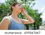young woman getting sweaty... | Shutterstock . vector #659367667