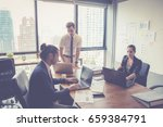 businesspeople with leader... | Shutterstock . vector #659384791