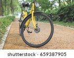 a yellow bicycle on the... | Shutterstock . vector #659387905