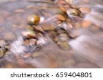 river and stone background | Shutterstock . vector #659404801