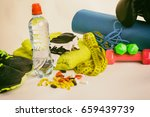 fitness equipment and pills on... | Shutterstock . vector #659439739