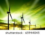 wind turbines farm at sunset | Shutterstock . vector #65944045